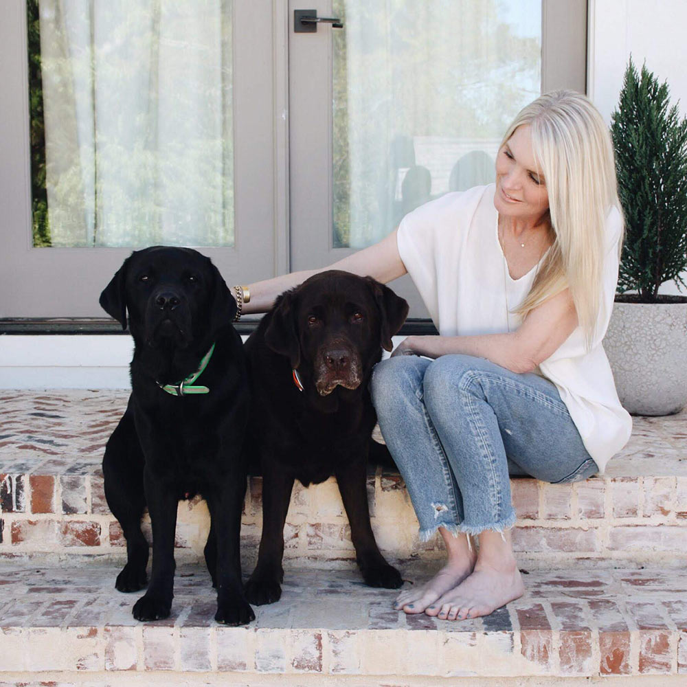 Kathryn sits with her two dogs. Kathryn is an anxiety therapist in Birmingham, AL and owner of Empower Counseling.