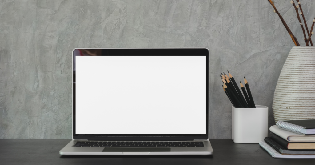 a blank computer laptop screen on a desk while parents are determining rules for screen time