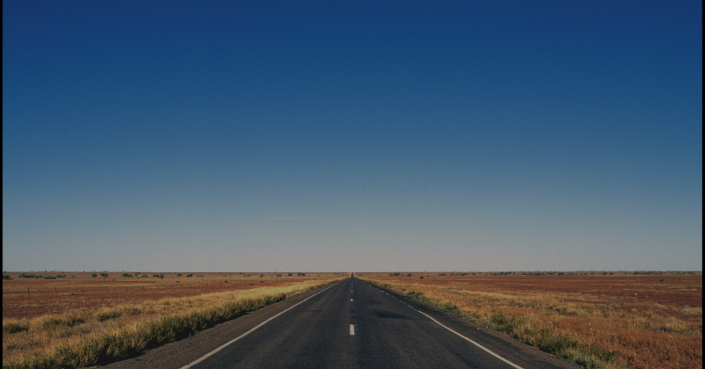 A long empty paved road on the way to life coaching at Empower Counseling & Coaching.