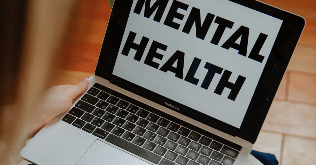 Laptop screen says Mental health on it before client begins online therapy with Empower Counseling in Birmingham, Alabama