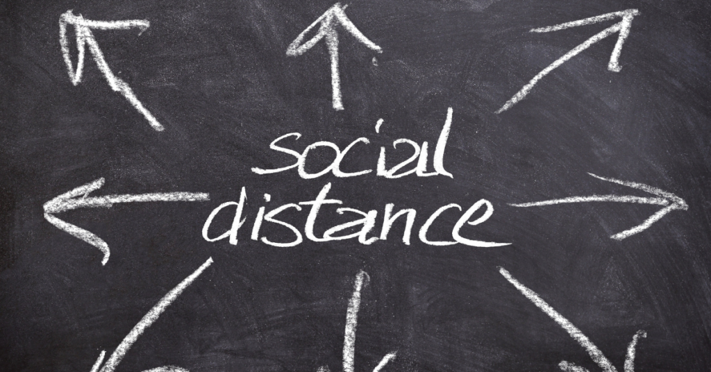 A sign that states social distance being looked at by college student in need of online counseling with Empower Counseling